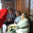 Sister Jeanie speaks with people in Waterloo
