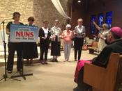 Bishop O'Connell and others bless NETWORK Nuns on the Bus